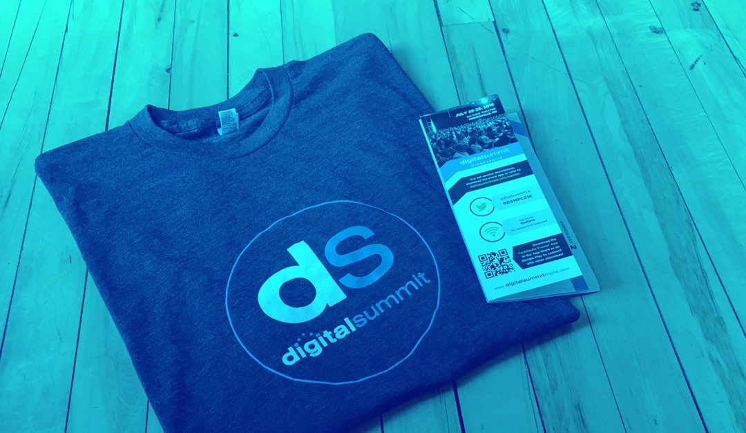 Close up of Shirt and brochure from the Digital Summit Conference