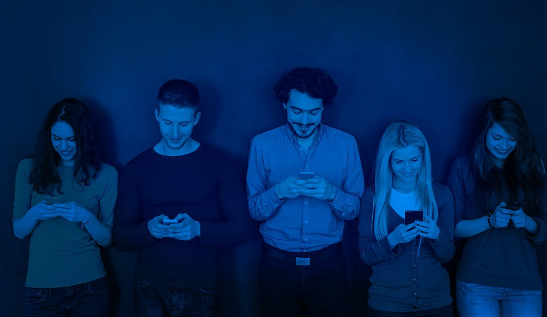 Group of Millennials looking at their phones