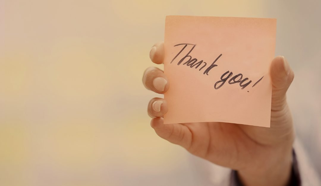 Thank you written on post-it